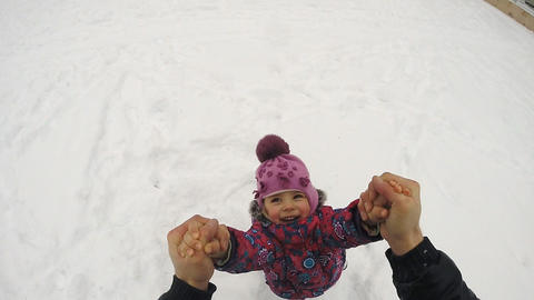 Happy Child Rotates and Fall on the Snow, Slow Motion Footage