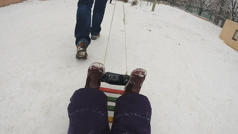 Father with Baby Drag the Sled, Slow Motion ビデオ