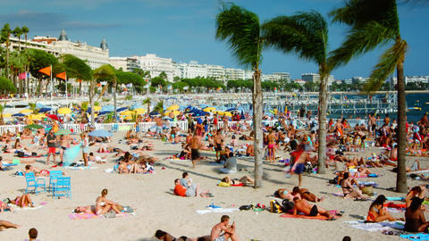 Beach Goers Enjoying Sunshine In Cannes, France stock footage
