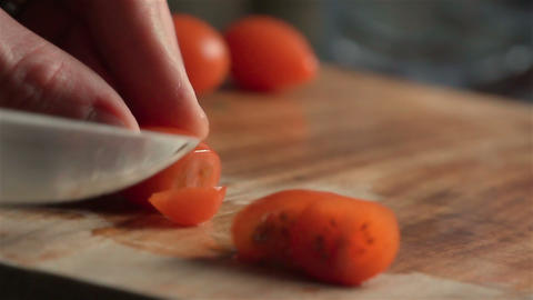 Slow motion of cherry tomatoes Footage