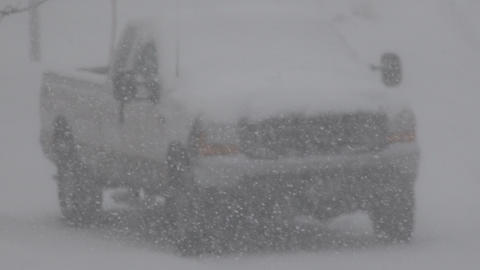 Parked Truck Snowing Hard stock footage