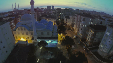 Low Flying Over A Mosque At Early Evening stock footage