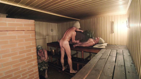 Men with brooms in the steam room. Russian bath Footage