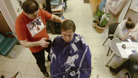 The man in the barbers trimmed Footage