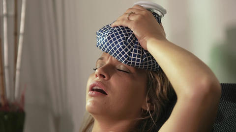 Woman With Headache Putting Ice On Head And Closin Footage