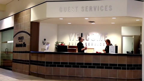 Two beautiful receptionist behind the service desk at guest service counter insi Footage
