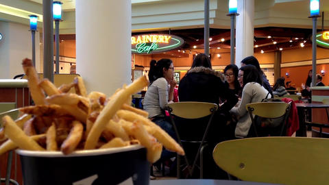Young People Enjoying Meal At Food Court With Front Motion Blur Fries stock footage