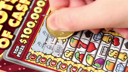Close up woman scratching lottery ticket Footage