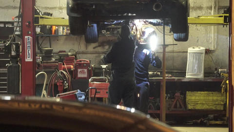 Scenes of Welding on a Car in a Garage (x of x) Footage