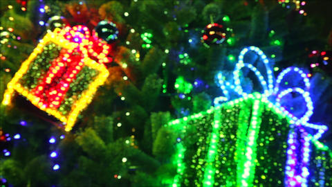 Shimmering Boxes With Gifts Hanging on Christmas Tree Footage