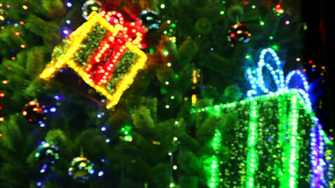 4K Shimmering Boxes With Gifts Hanging on Christmas Tree Footage
