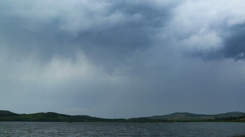 approaching storm - storm clouds over lake - timelapse Footage