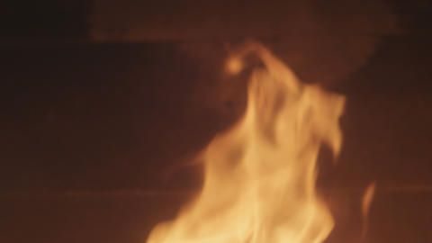 closeup of fireplace with burning wood shot in slow motion handheld camera tilti Footage