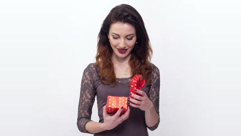 beautiful girl taken by surprise opening gift box Footage