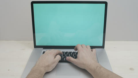 Hands Typing On Notebook With Green Screen stock footage
