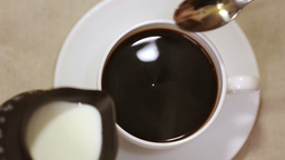 Espresso in white cup and saucer with spoon Footage