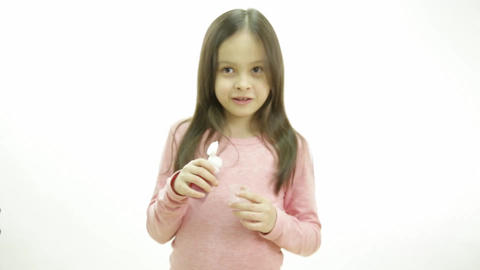 Young girl taking medicine by herself, Live Action
