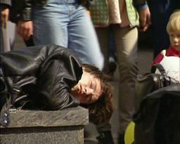 man sleeps in city crowd Stock Video Footage