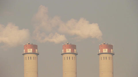 Industrial Scene Smoking Steaming Factory Towers 01 neutral Stock Video Footage