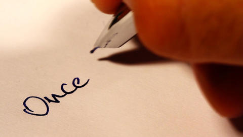 Once Upon a Time handwriting macro shot Stock Video Footage