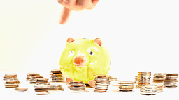 Putting Money into Pig Money Box and Coins 04 Stock Video Footage