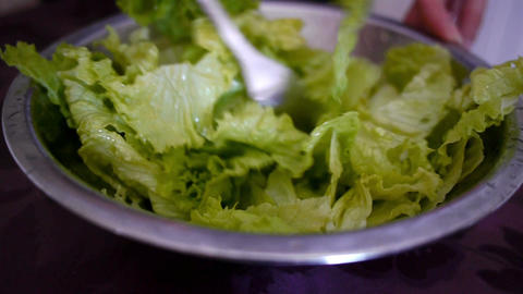 Woman mixing green salad Footage