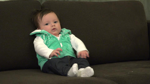 Baby Sitting Up On Couch Crying Out stock footage