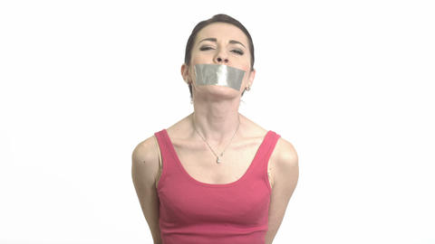 Abused Woman In Red With Gaffer Tape On Her Mouth Experiencing Emotional Pain Is stock footage