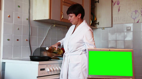 Woman in the kitchen preparing breakfast. Green screen Live Action