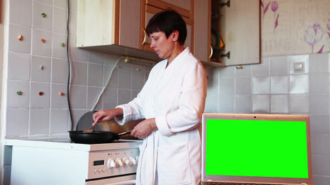 Woman prepares food in the kitchen. Green screen Live Action