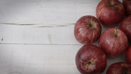 Red apples against a rustic white background HD stock footage Footage