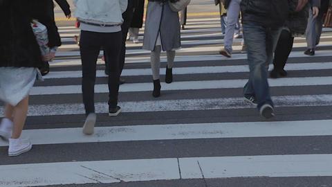 feet and legs of people crossing Shibuya street Footage