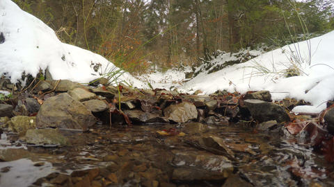4k, The snow melts, the creek flows Footage