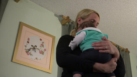 Mom Bouncing And Comforting Baby - Low Angle stock footage