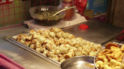 Dumplings cooking at vendors in Lehua Night Market Footage
