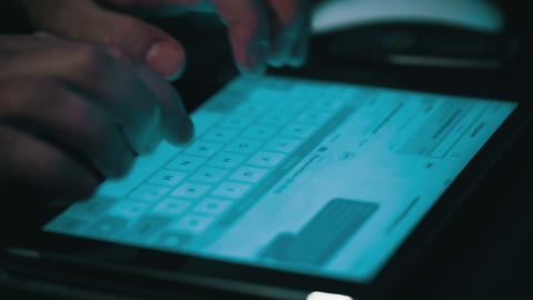 Male Hands Typing on a Tablet Computer Footage