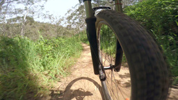 4k video of mountain biking on a dirt road Footage