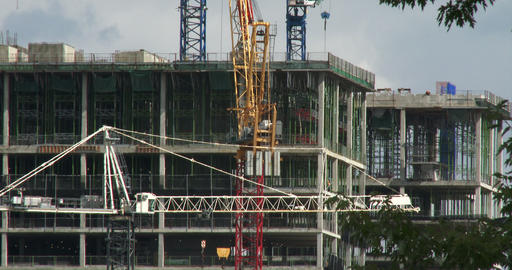 Cranes on construction site around buildings Footage