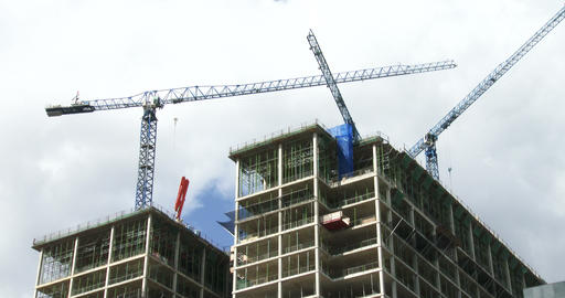 Cranes on construction site around skyscrapers Footage