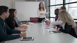 A Young Attracive Professional Leads a Meeting (3 of 8) Live Action