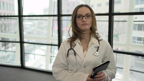 A Caucasian Female Medical Professional Walks Up to the Camera (7 of 9) Footage