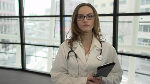 A Caucasian Female Medical Professional Walks Up to the Camera (6 of 9) Footage