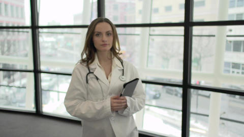 A Caucasian Female Medical Professional Walks Up To The Camera (4 Of 9) stock footage