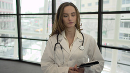 A Caucasian Female Medical Professional Walks Up to the Camera (2 of 9) Footage