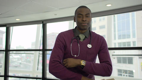 A Black Male Medical Professional Walks Up to the Camera (4 of 5) Live Action