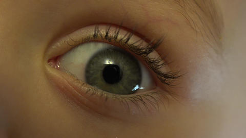 Close-up Macro Shot of Little Girl Eye Blinking. 4K, UHD, Ultra HD resolution Footage
