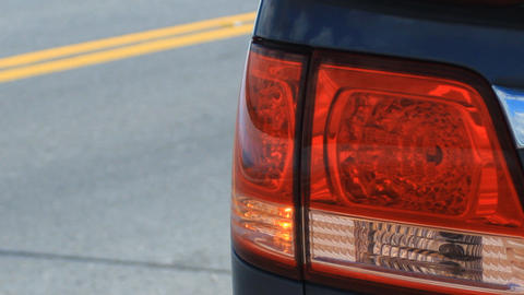 Tail light flashing on side of road Footage