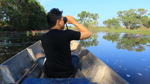 birdwatcher working on the boat trip in the bird swamps Footage
