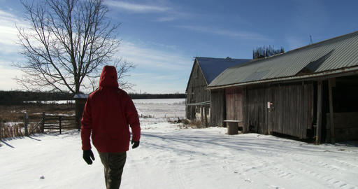 Farmer walking on his farm in winter Footage