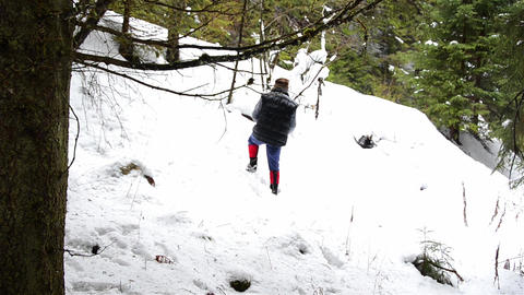 Mountaineer climbing a hill a Footage
